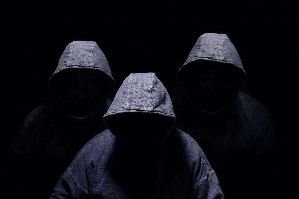 three hooded men