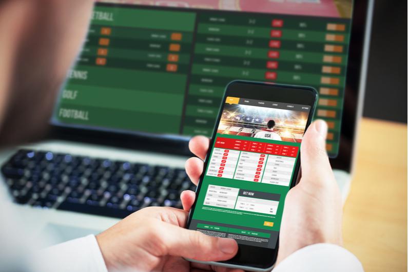 Businessman betting on smartphone