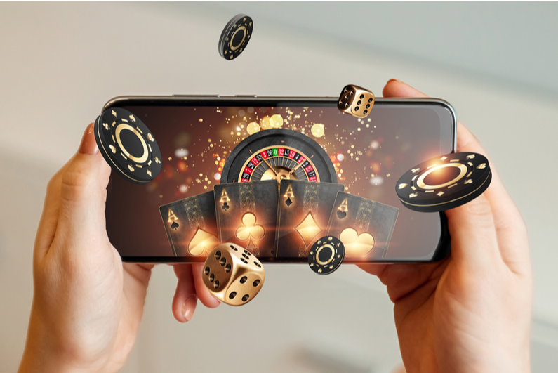 Smartphone with casino items flying out of it